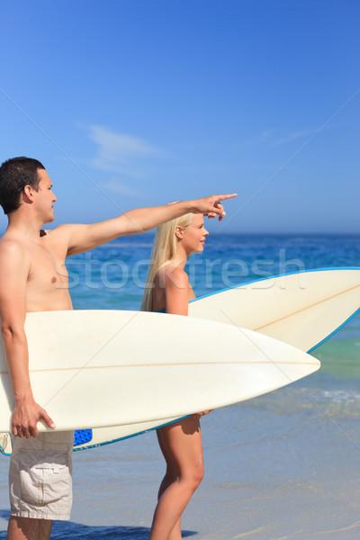 Szerelmespár szörfdeszkák nő víz szeretet sport Stock fotó © wavebreak_media