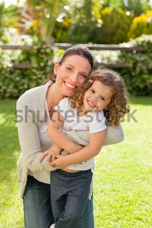 Mother and her daughter laughting in the park Stock photo © wavebreak_media