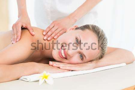 Collage of young woman having a stone massage Stock photo © wavebreak_media