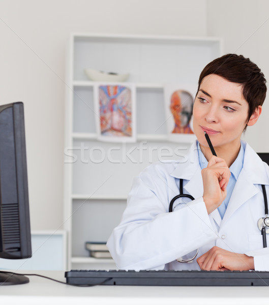 Portrait of a thoughful female doctor in her office Stock photo © wavebreak_media