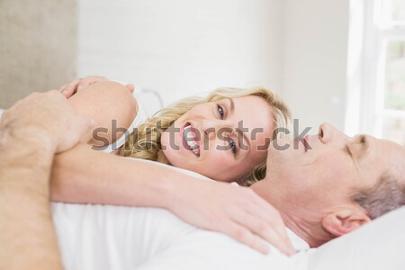 Angry woman awaken by her boyfriend's snoring in their bedroom Stock photo © wavebreak_media