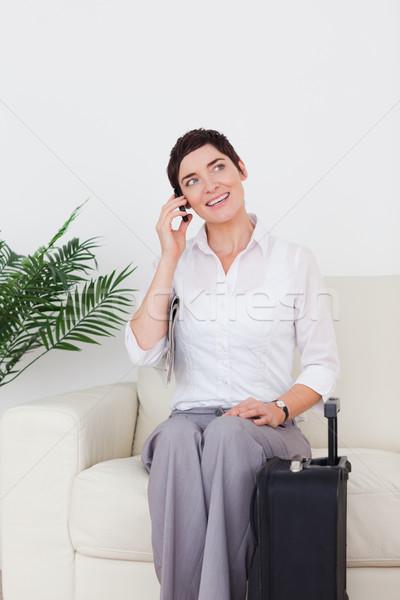 Telefono donna valigia sala di attesa telefono felice bag Foto d'archivio © wavebreak_media