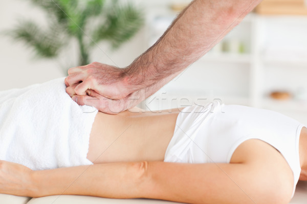 Cute Woman getting a back-massage in a room Stock photo © wavebreak_media