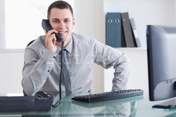 Imprenditore una buona notizia telefono business computer lavoro Foto d'archivio © wavebreak_media