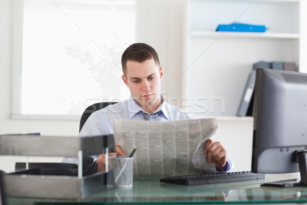 Young businessman reading the newspaper Stock photo © wavebreak_media