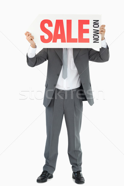 Businessman with sign in front of his head against a white background Stock photo © wavebreak_media