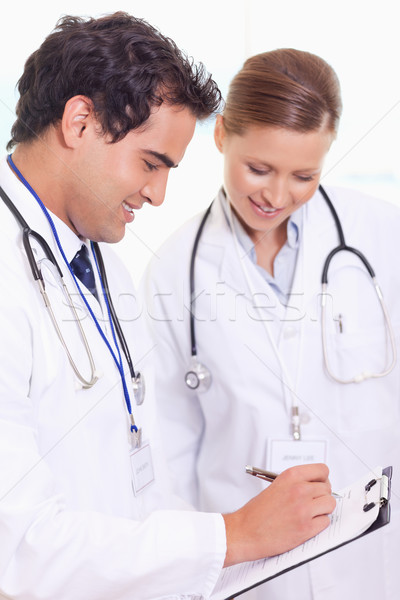 Young assistant doctors taking notes Stock photo © wavebreak_media