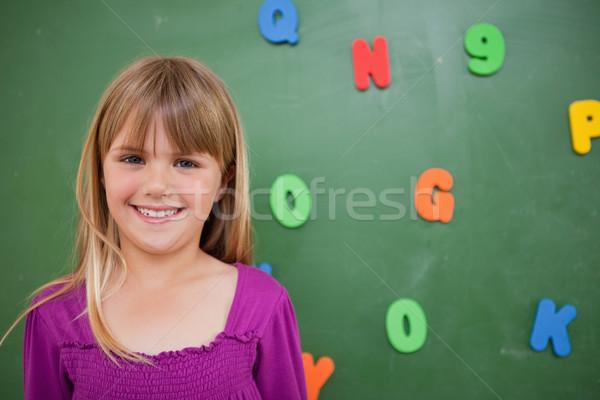 女学生 ポーズ 黒板 教室 笑顔 ストックフォト © wavebreak_media