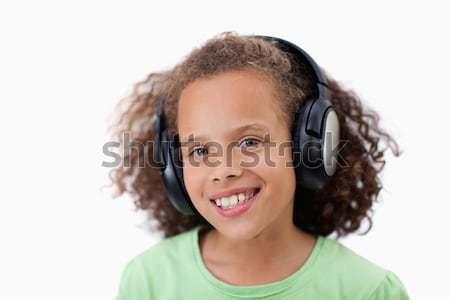 Fille heureuse écouter de la musique blanche bébé visage technologie Photo stock © wavebreak_media
