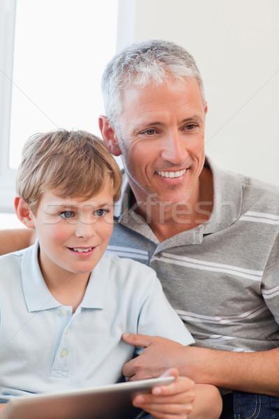 портрет улыбаясь отцом сына гостиной семьи Сток-фото © wavebreak_media