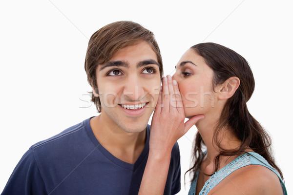 Bájos nő suttog valami fehér szeretet Stock fotó © wavebreak_media