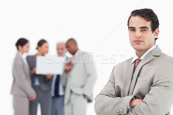 Imprenditore braccia piegato squadra dietro bianco Foto d'archivio © wavebreak_media