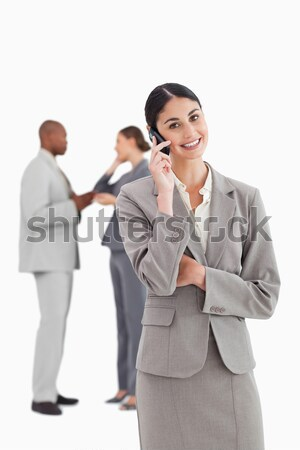 Glimlachend verkoopster collega's achter witte Stockfoto © wavebreak_media