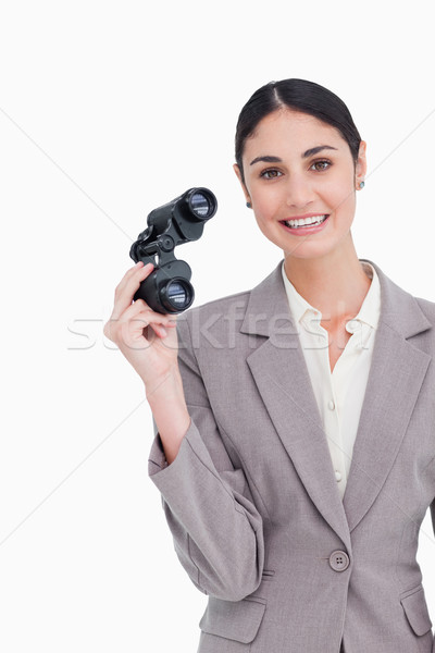 Smiling businesswoman with spy glasses against a white background Stock photo © wavebreak_media