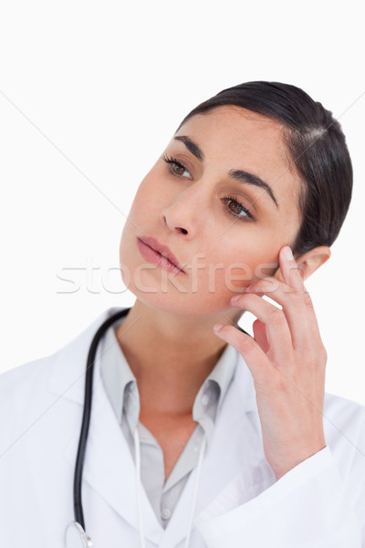 Close up of thoughtful female doctor against a white background Stock photo © wavebreak_media