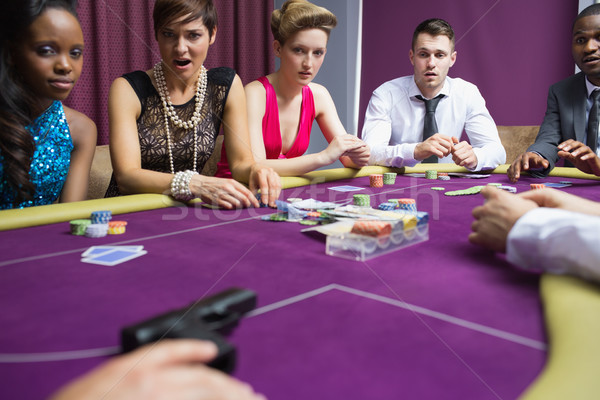 People looking scared at gun on poker table in casino Stock photo © wavebreak_media