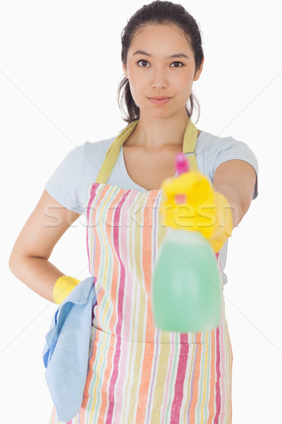 Smiling woman spraying cleaner in apron and rubber gloves Stock photo © wavebreak_media