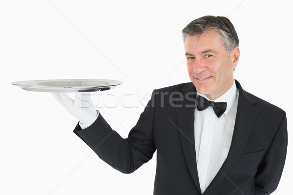 Waiter holding a silver tray and smiling Stock photo © wavebreak_media