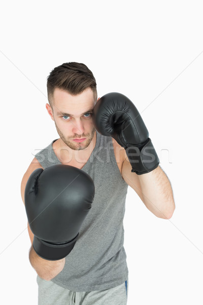Portrait of young man in boxing stance Stock photo © wavebreak_media