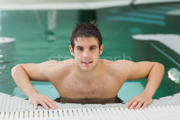 Man getting out of swimming pool Stock photo © wavebreak_media