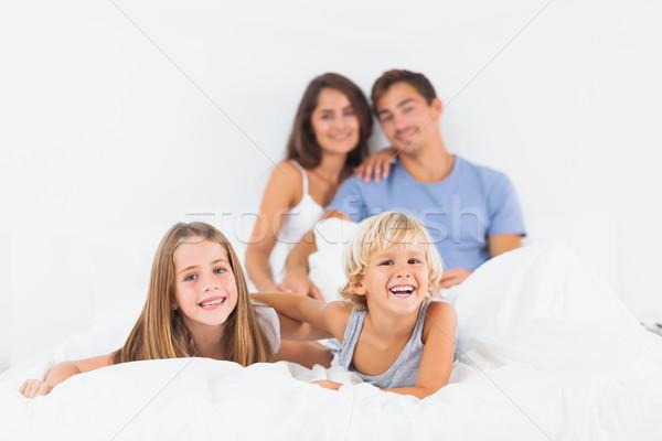 Offspring lying on the bed Stock photo © wavebreak_media
