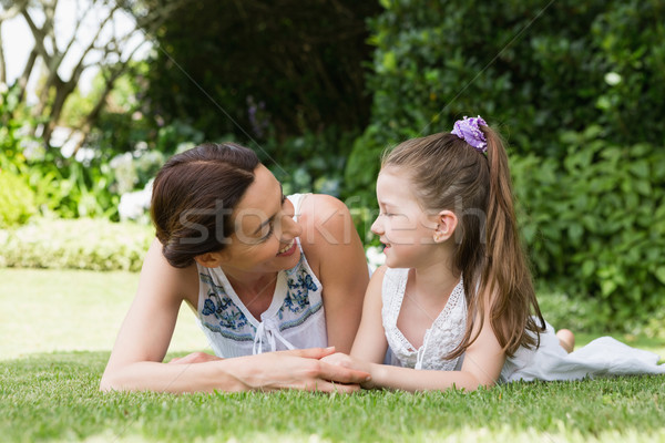 Mother and daughter smiling at each other Stock photo © wavebreak_media