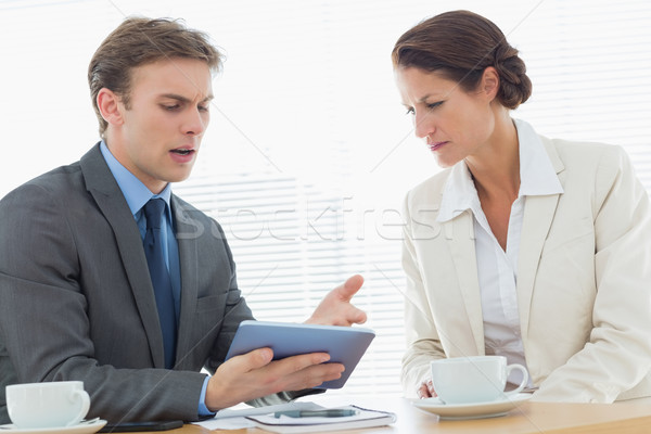 Smartly dressed couple in a business meeting Stock photo © wavebreak_media