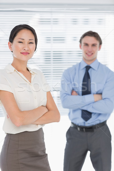 Business colleagues with arms crossed in office Stock photo © wavebreak_media