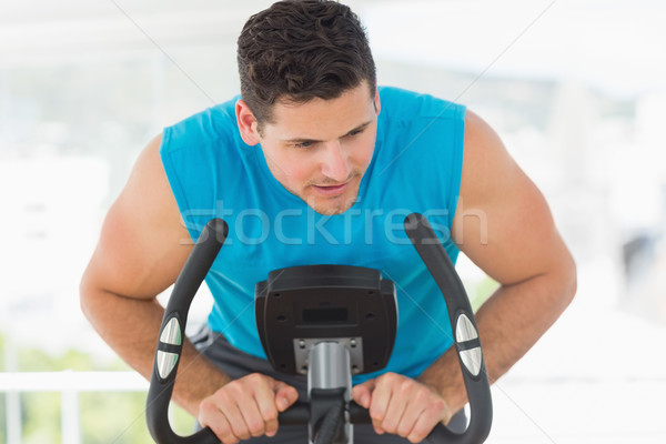 Serious man working out at spinning class Stock photo © wavebreak_media