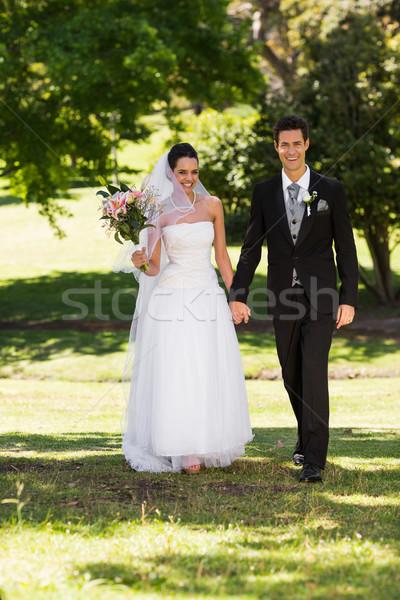 новобрачный пару , держась за руки ходьбе парка Сток-фото © wavebreak_media