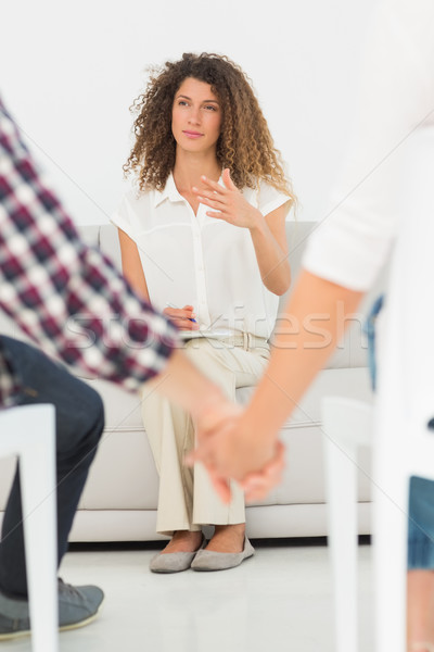 Therapist looking at reconciled couple holding hands Stock photo © wavebreak_media