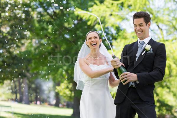 Newlywed couple popping cork of champagne Stock photo © wavebreak_media