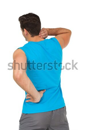 Rear view of man in sportswear suffering from neck ache Stock photo © wavebreak_media