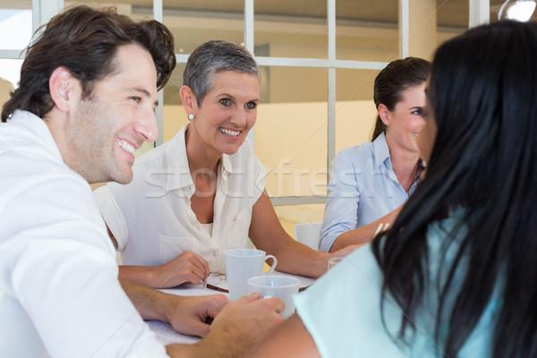 Pessoas de negócios sorrir conversar quente bebidas Foto stock © wavebreak_media