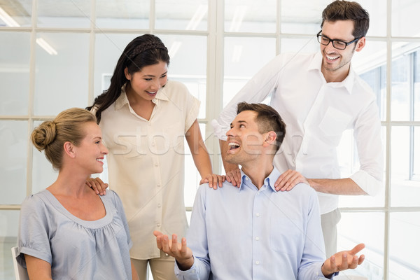 Casual business team congratulating colleague Stock photo © wavebreak_media