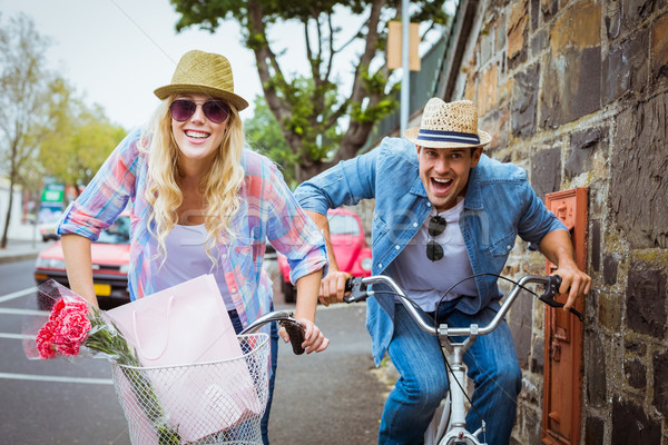 Hip young couple on a bike ride Stock photo © wavebreak_media