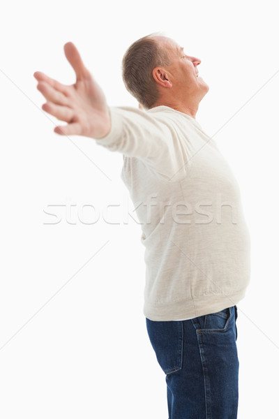 Happy mature man with hands out Stock photo © wavebreak_media