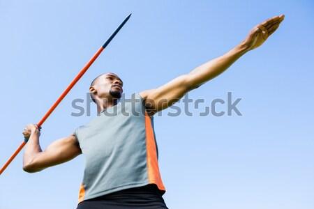Happy football player in blue celebrating Stock photo © wavebreak_media