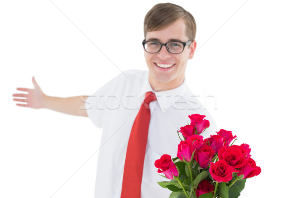 Nerdy hipster offering bouquet of roses Stock photo © wavebreak_media