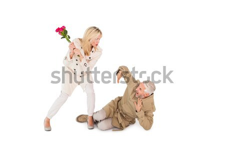 Angry woman attacking partner with rose bouquet Stock photo © wavebreak_media