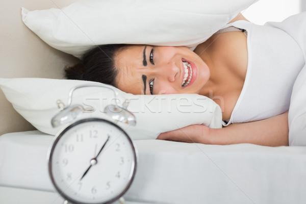Nő fülek párnák ágy ébresztőóra oldal Stock fotó © wavebreak_media
