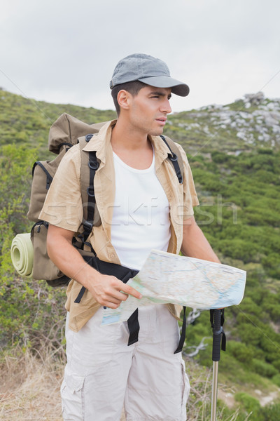 Hiking man holding map on mountain terrain Stock photo © wavebreak_media