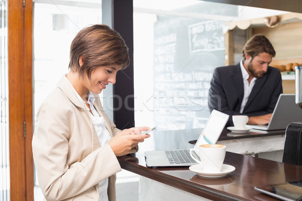 Pretty businesswoman working on her break on laptop Stock photo © wavebreak_media