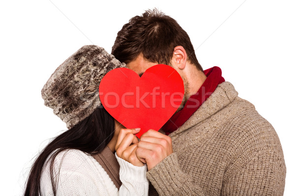 Young couple kissing behind red heart Stock photo © wavebreak_media