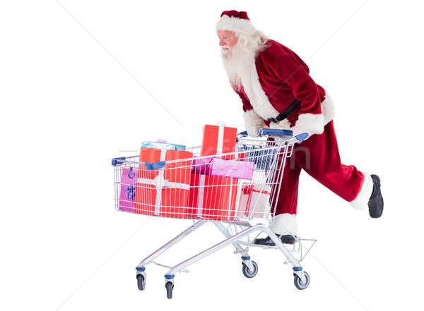 Santa rides on a shopping cart Stock photo © wavebreak_media