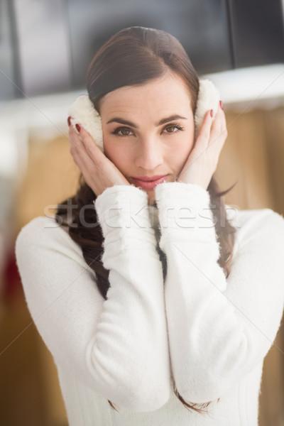 Pretty brunette with ear muffs  Stock photo © wavebreak_media