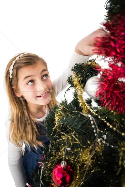 Festive little girl decorating christmas tree Stock photo © wavebreak_media