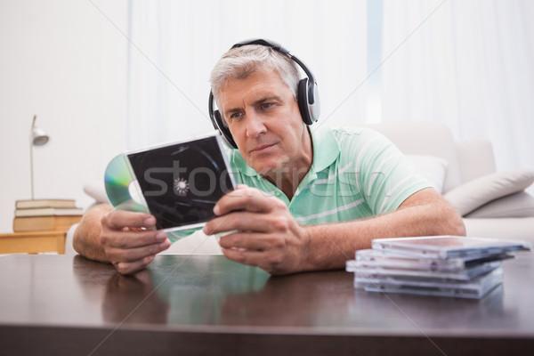 Olgun adam dinleme cds ev oturma odası erkek Stok fotoğraf © wavebreak_media