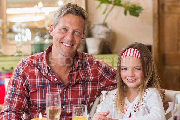 Lezser apa lánygyermek mosolyog kamera otthon Stock fotó © wavebreak_media