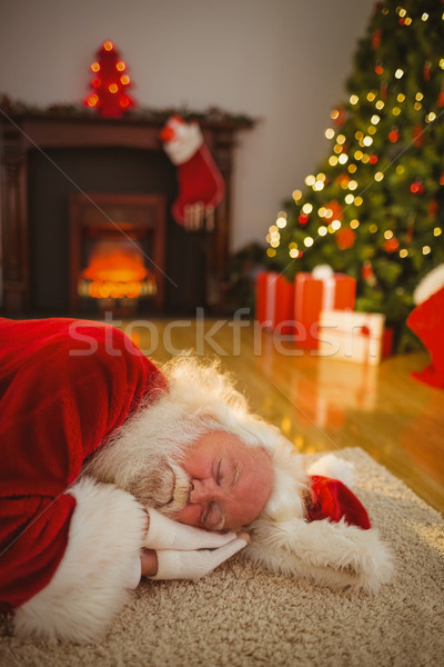 Santa claus napping on the rug Stock photo © wavebreak_media
